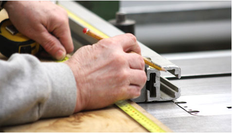 Photo of a carpenter measuring wood
